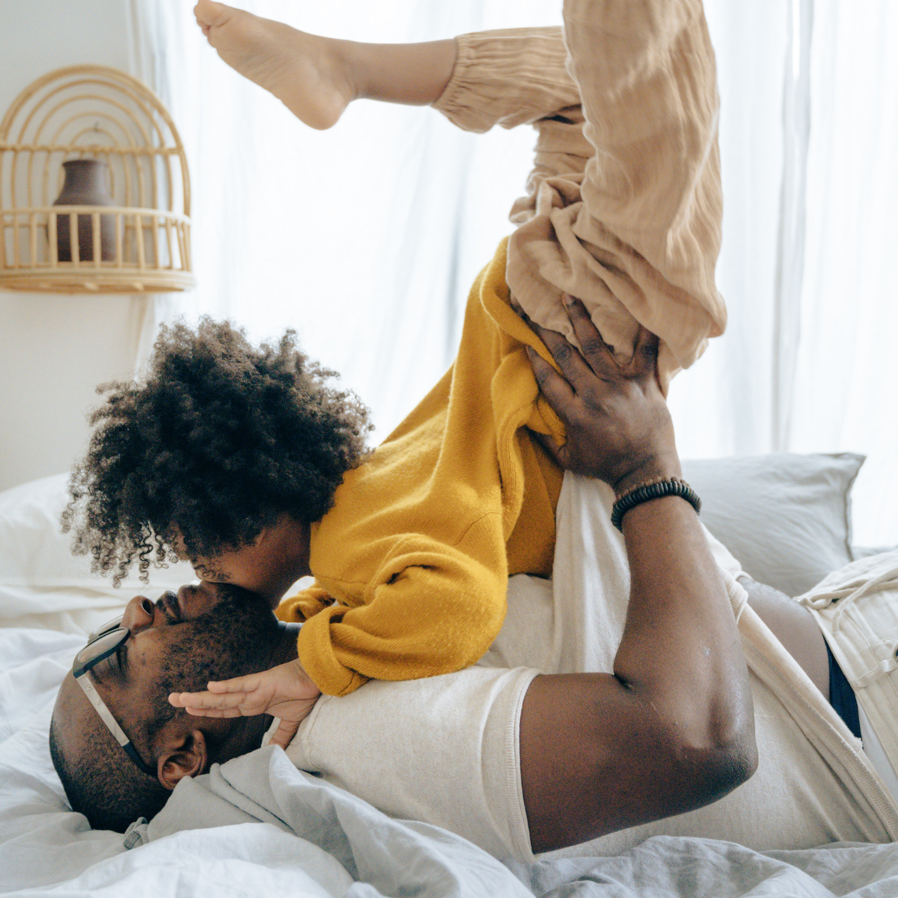 Father playing airplane with child