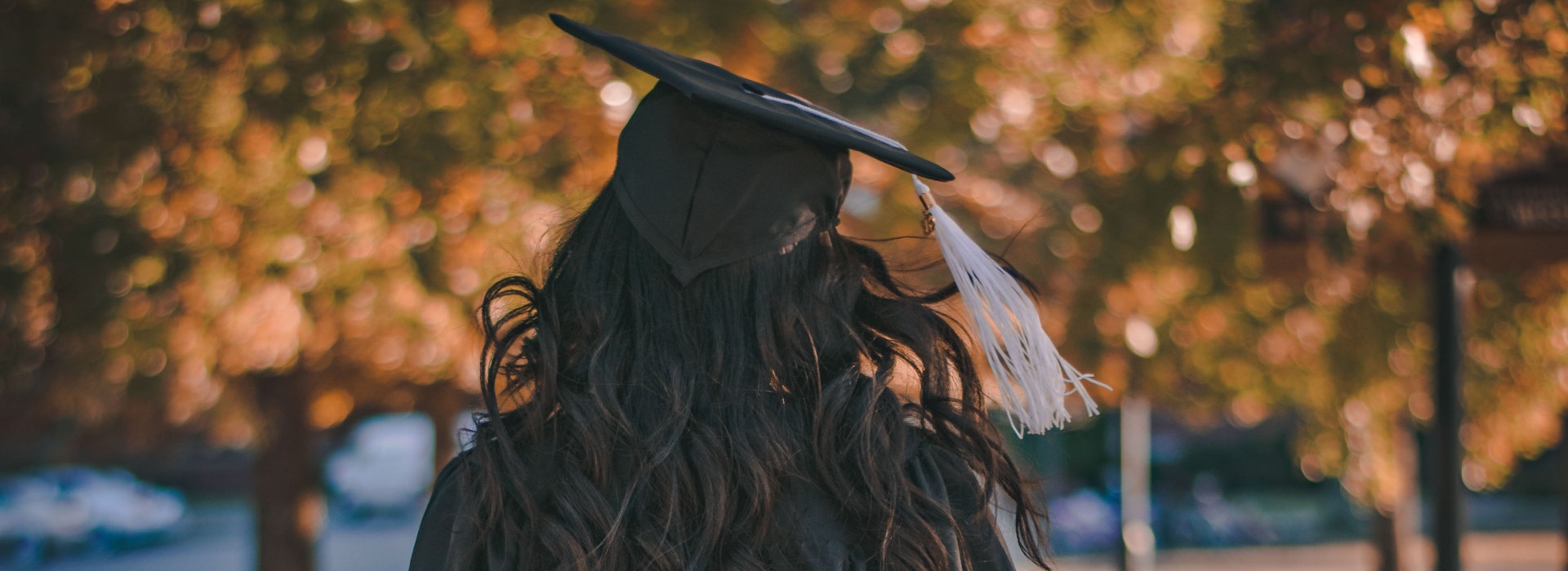 Girl with a graduation cap and gown