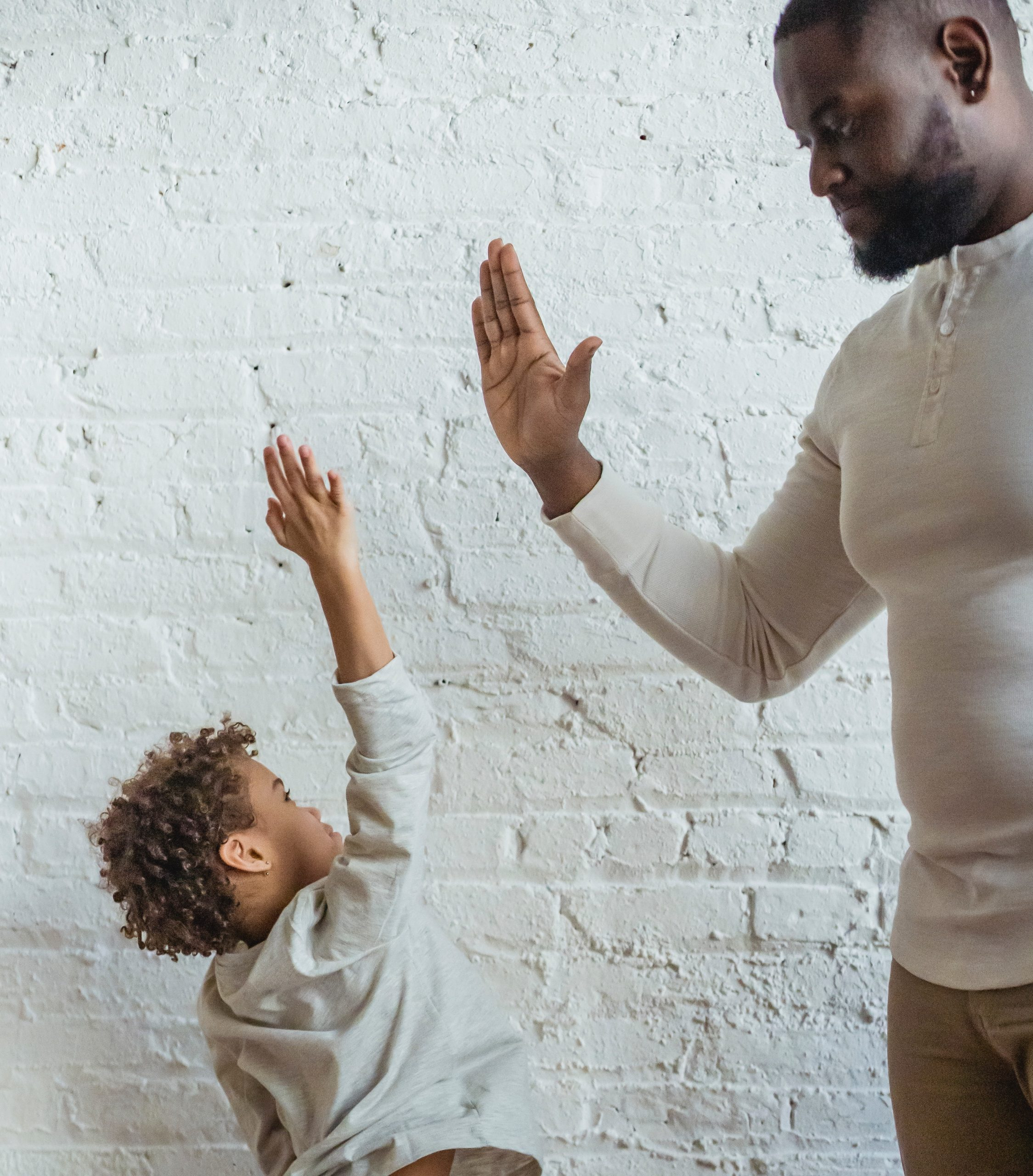 Dad giving his son a high five