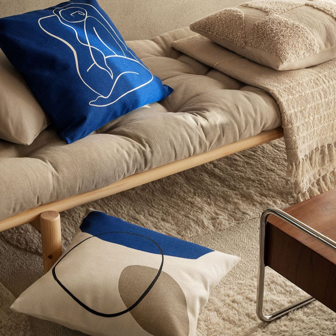 Contemporary Line work inspired pillow accents in blue and cream