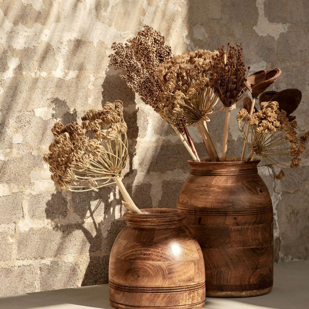 Dried flowers in two wooden vases