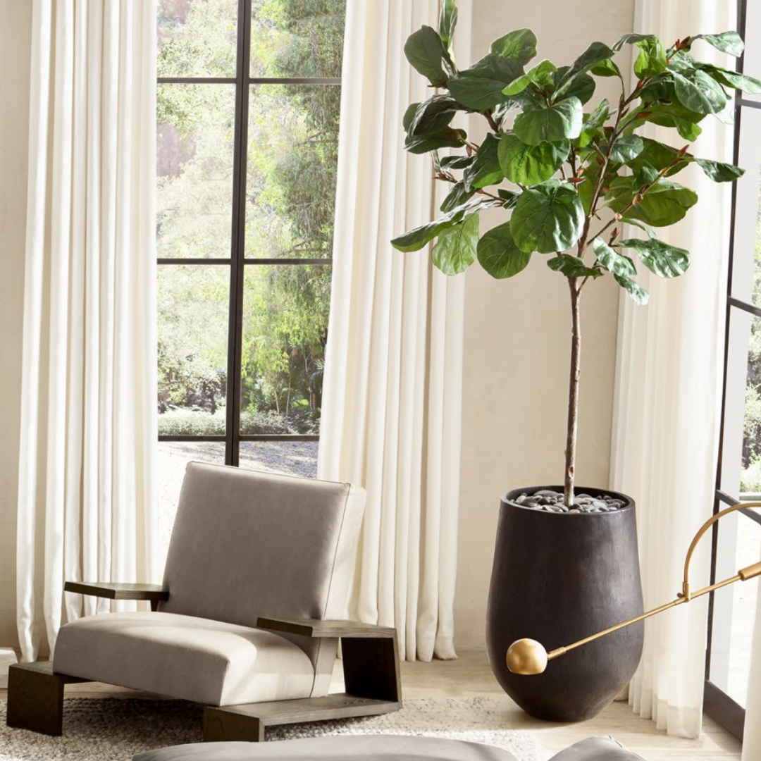 Faux plant in a black clay pot
